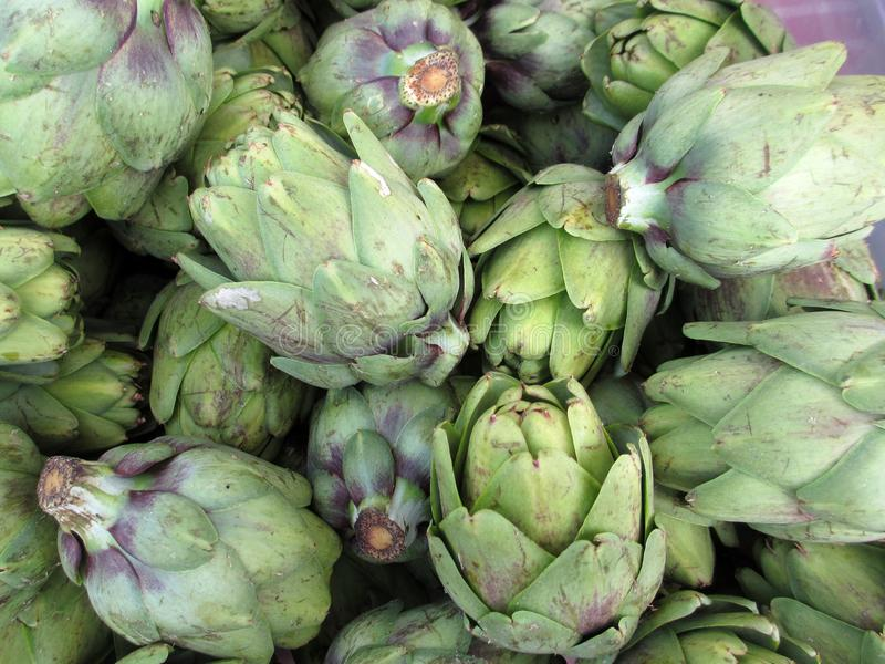 Pile of Artichoke. On display at a farmers market in San Francisco, CA, artichokes, background, bunch, buy, closeup, color, cook, cooking, delicious, diet, eat royalty free stock photos