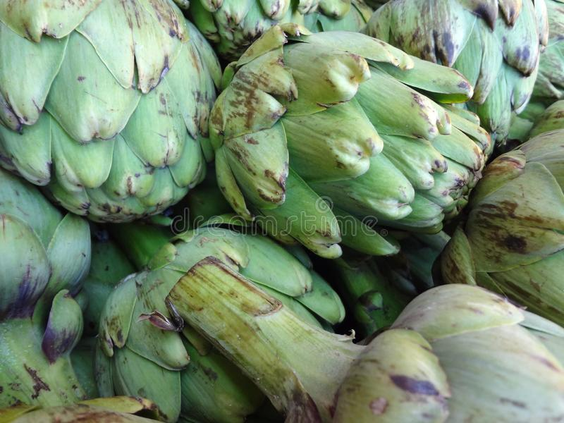 Pile of Artichoke. On display at a farmers market in San Francisco, CA, artichokes, background, bunch, buy, closeup, color, cook, cooking, delicious, diet, eat royalty free stock images