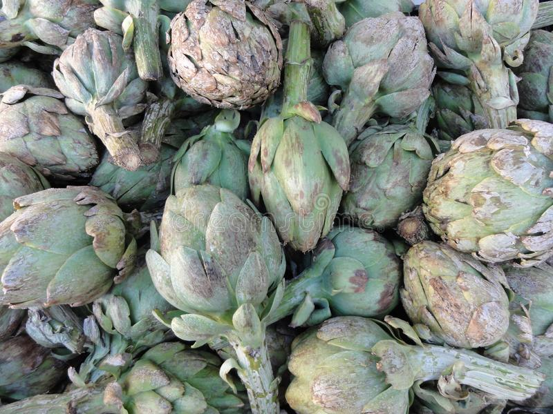 Pile of Artichoke. On display at a farmers market in San Francisco, CA, artichokes, background, bunch, buy, closeup, color, cook, cooking, delicious, diet, eat stock image