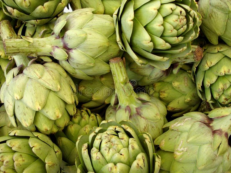 Pile of Artichoke. On display at a farmers market in San Francisco, CA, artichokes, background, bunch, buy, closeup, color, cook, cooking, delicious, diet, eat stock photography