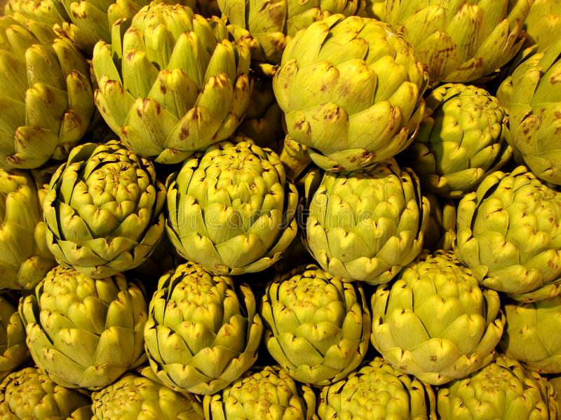 Pile of Artichoke. On display at market in San Francisco, CA, artichokes, background, bunch, buy, closeup, color, cook, cooking, delicious, diet, eat, eating royalty free stock images