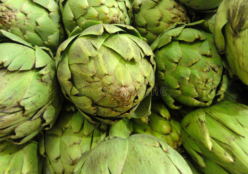 Pile of Artichoke on display at a store stock images