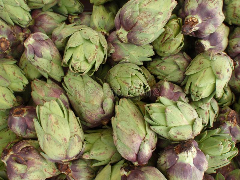Pile of Artichoke. Pile of small Artichoke on display at a farmers market in San Francisco, CA, artichokes, background, bunch, buy, closeup, color, cook, cooking royalty free stock photos