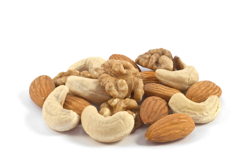 Pile of assorted nuts close up isolated royalty free stock photo