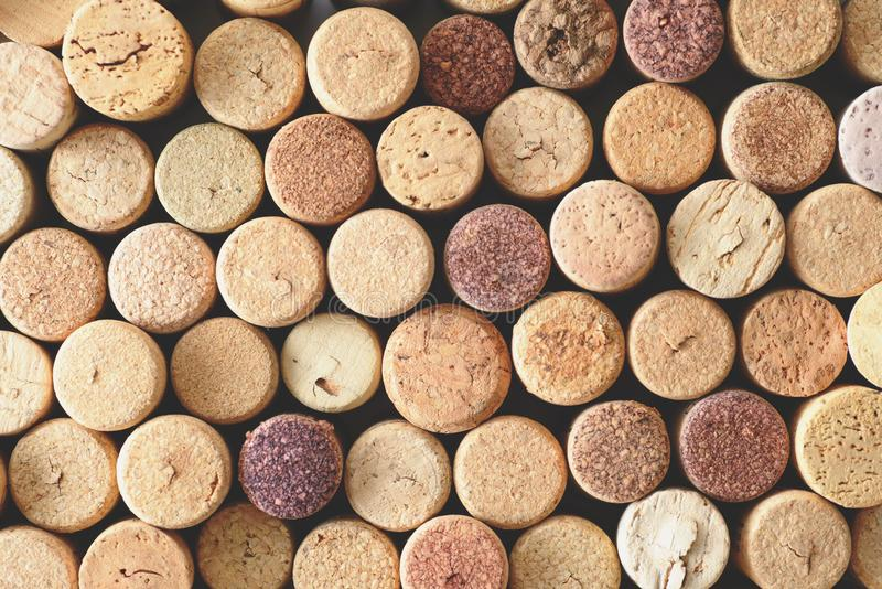 Pile of assorted used wine corks background. Close up top view. royalty free stock photo