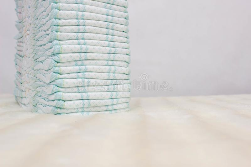 Pile of baby diapers on a white background, protection against leakage, dryness and comfort, hygiene, lightness. Pile of baby diapers on a white background royalty free stock photos