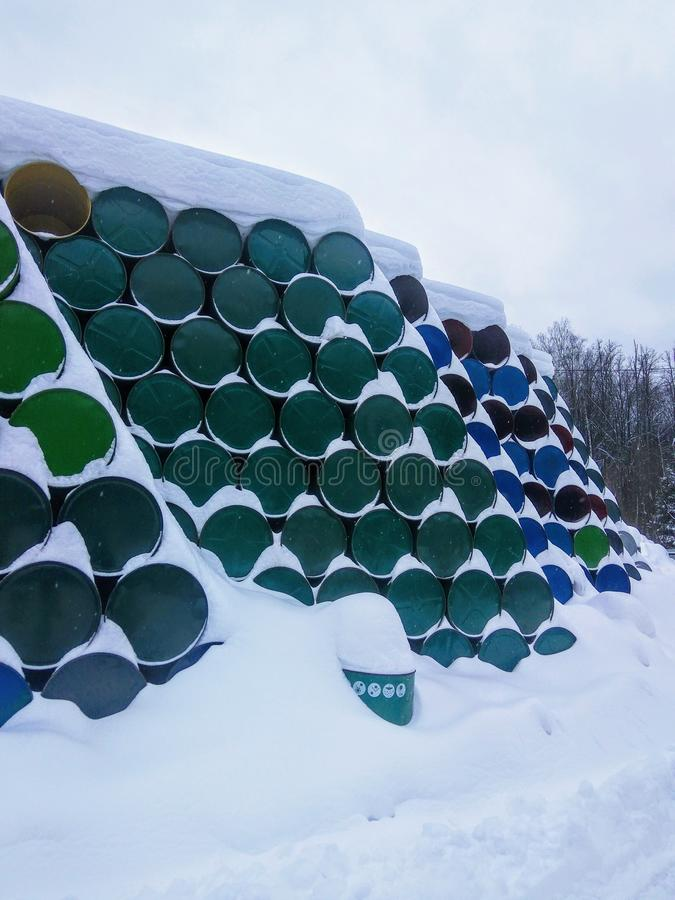 Pile of barrels. Under the snow waste dump stock photography