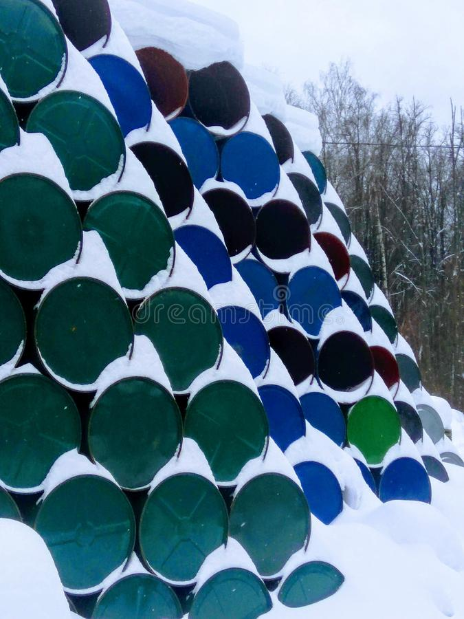 Pile of barrels. Under the snow waste dump stock photo