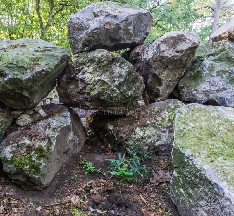 Pile of big boulder stone rocks stacked on a pile a beautiful garden decoration background. A pile of big boulder stone rocks stacked on a pile a beautiful stock images
