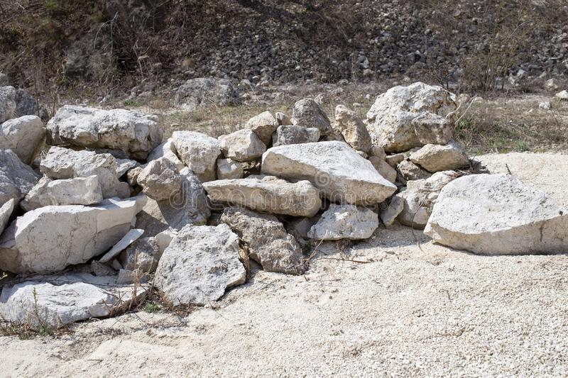 Pile of big white limestones. Can be used as wallpaper for a monitor royalty free stock photos