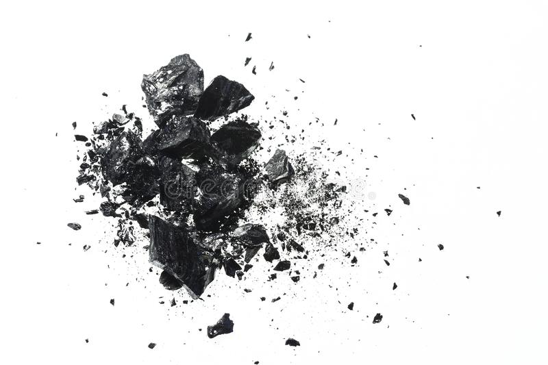 Pile of black coal bars isolated on white background royalty free stock images
