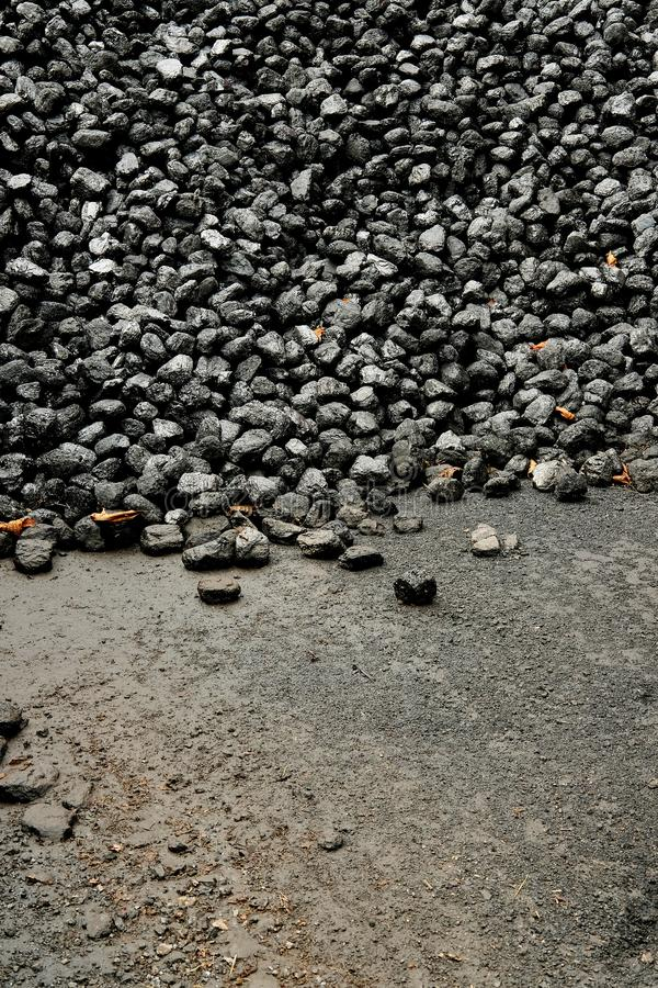 Pile of black coal at a railway station coal shed. stock photo