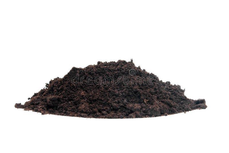 Pile of black garden soil. Pile of black garden top soil over white background stock photo