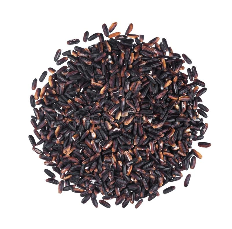 Pile of black rice groats isolated on white background. Top view stock images