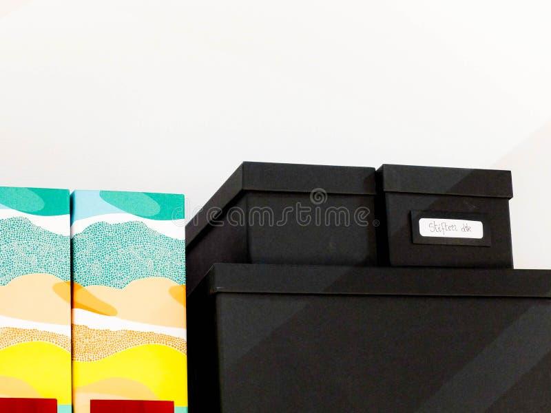 Pile Of Black Shoe Box Next To Wall Free Public Domain Cc0 Image