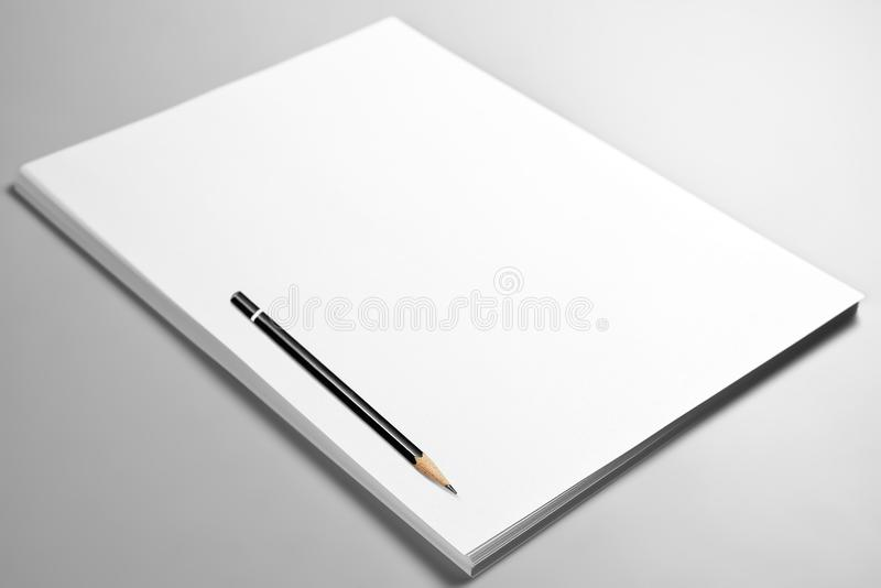 Heap of blank sheets of paper and pencil stock photos