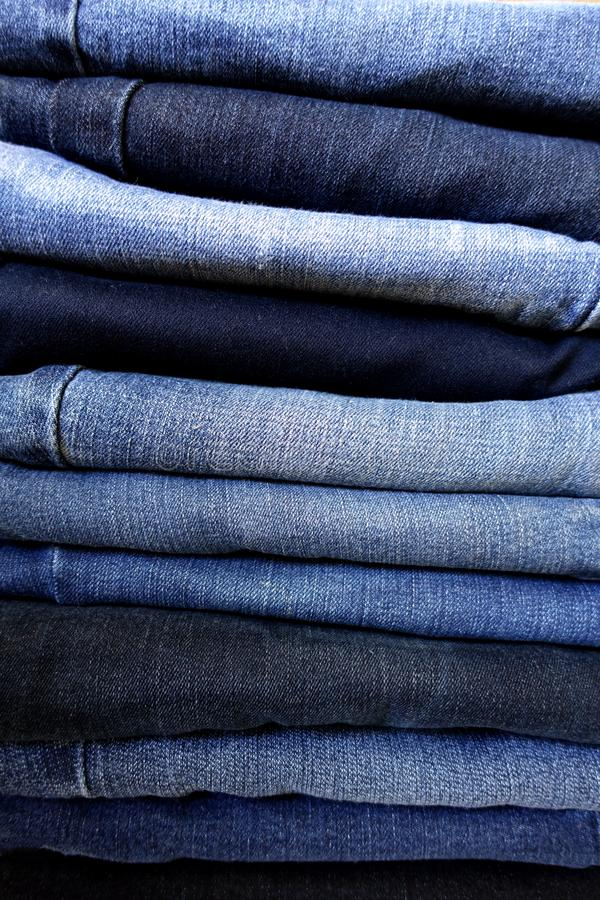 Stack of Blue Jeans - Varying Shades of Washed Denim royalty free stock images