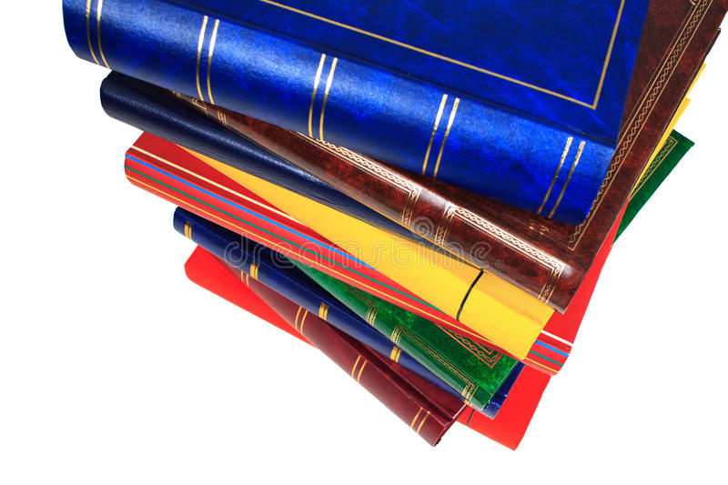 Pile of books. In closeup on white background stock image