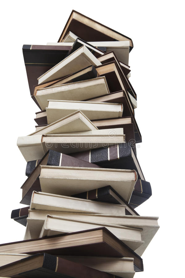 Pile of books. High stack of books shot in studio isolated on white background stock photo