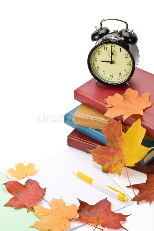 Pile of books and autumn leaves stock photos