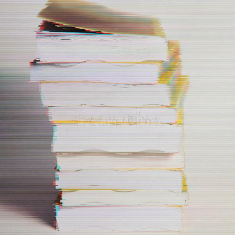 Pile of books in glitch effect. Creative design background royalty free stock images