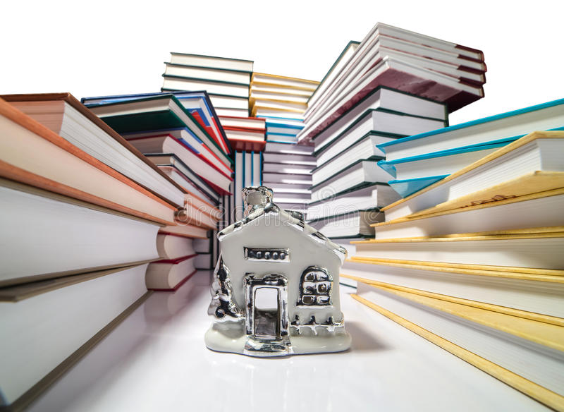 Pile of books and a house stock photo