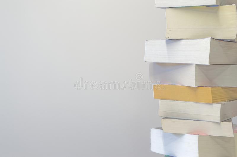 Pile of books on the light grey background. Pile of books on the right side and with light grey background stock images