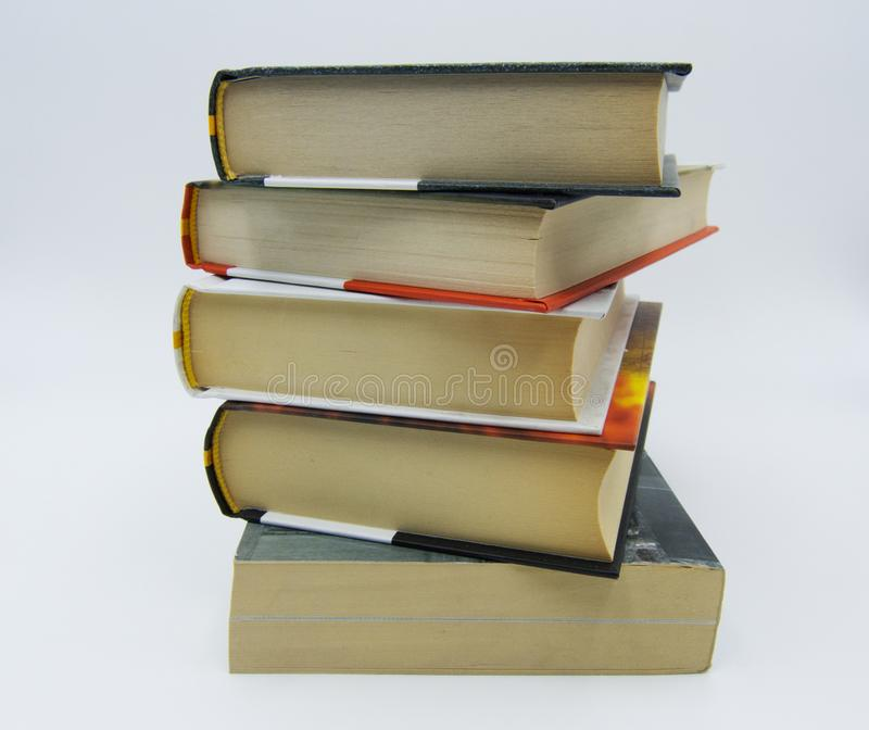 Pile of books on a table in white background. Pile of books on a white table in white background stock image