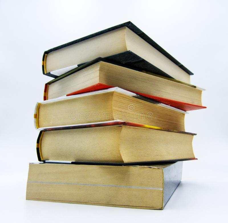 Pile of books on a table in white background. Pile of books on a white table in white background stock photography