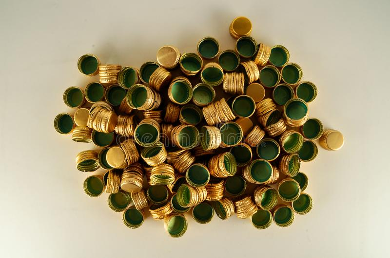 Pile of bottle metal caps as pattern background, royalty free stock image