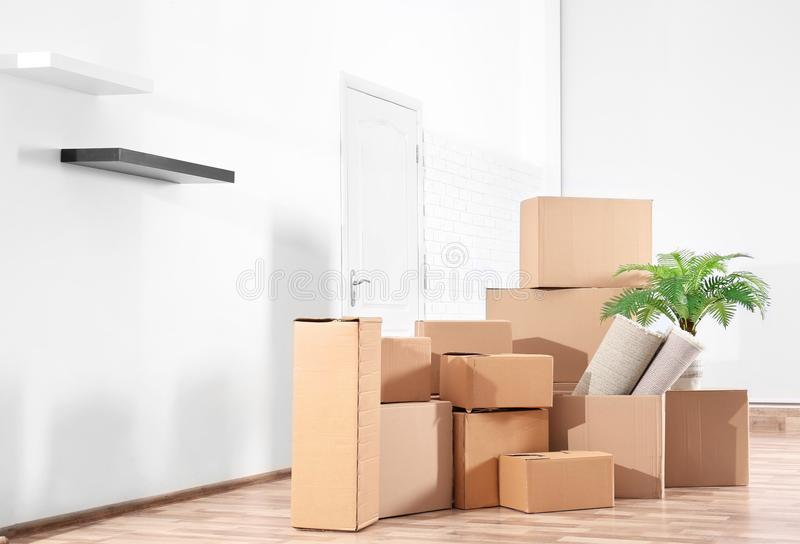 Pile of boxes for moving stock images