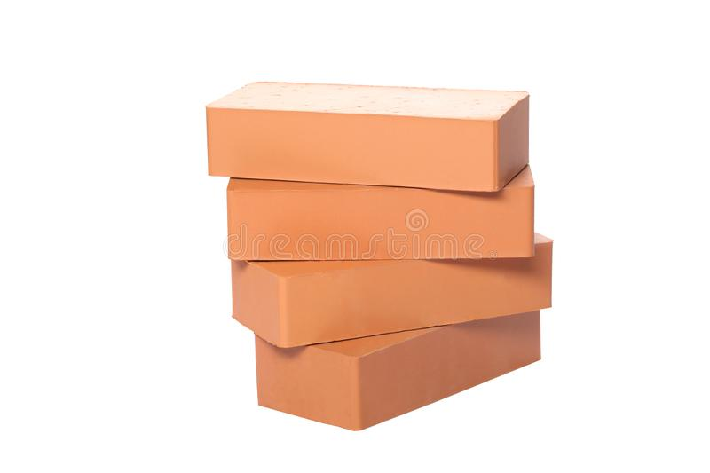 Pile of bricks isolated on white background with clipping path and copy space for your text royalty free stock photo