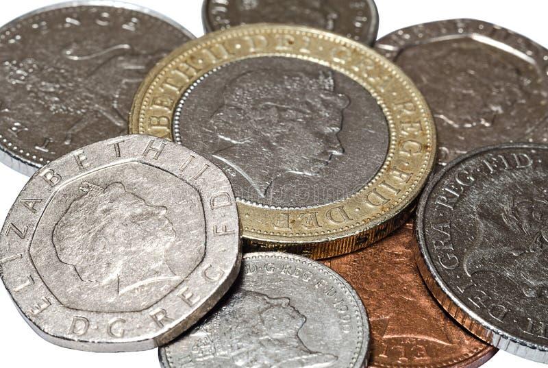 Pile of British coins closeup stock images