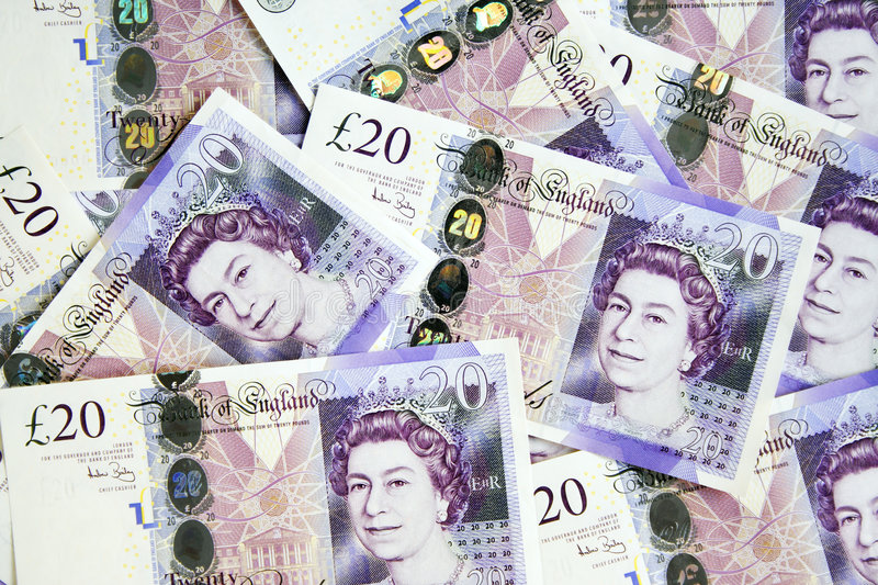 A pile of British twenty pounds currency royalty free stock photography
