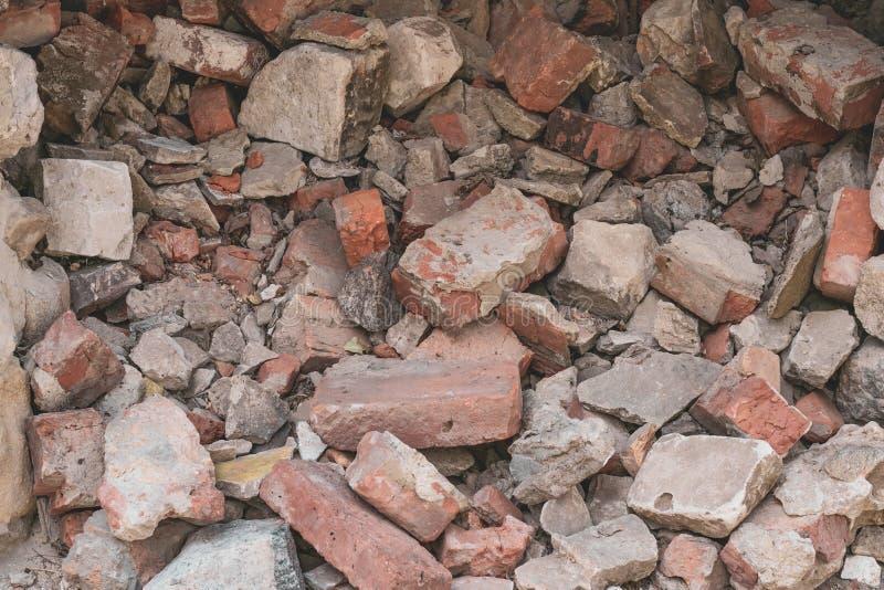 Pile of broken bricks. Grunge background. Red brick. Antique texture. Danger of destruction building. Pile of broken bricks. Grunge background. Red brick stock photos