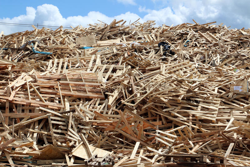 Pile of broken pallets. Huge pile of used broken pallets on factory field royalty free stock photo