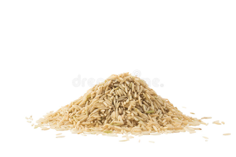 Pile of brown basmati rice isolated on white. Background royalty free stock photo