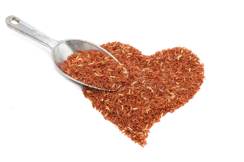 Pile of brown rice in heart shape stock image