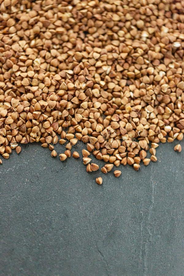 Pile of buckwheat isolated on white background. Top view. Raw organic buckwheat, soft focus. Horizontal food background with space for text. Close up and top royalty free stock photo
