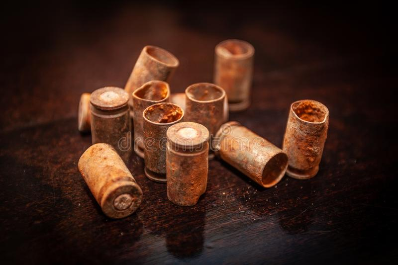 A pile empty bullet shells on a wooden background royalty free stock images