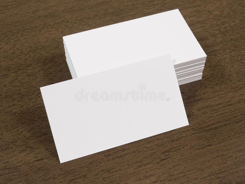 Pile Of Business Cards On A Wooden Desk Stock Photo - Image: 57012788