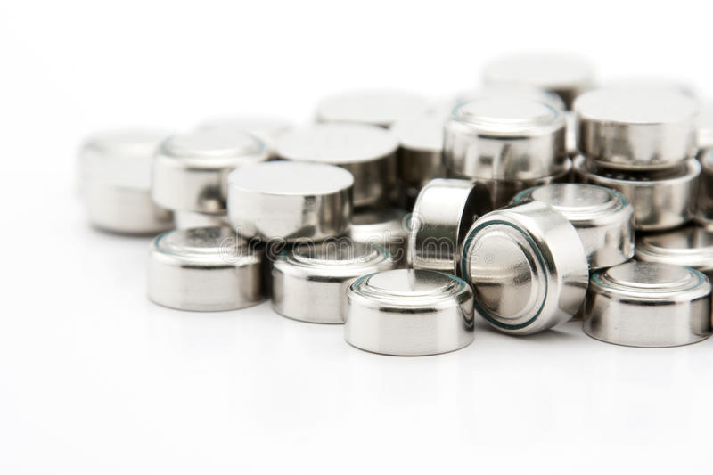 Pile of button cell batteries royalty free stock photos