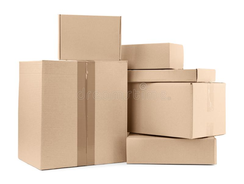 Pile of cardboard boxes on background. Pile of cardboard boxes on white background stock photography