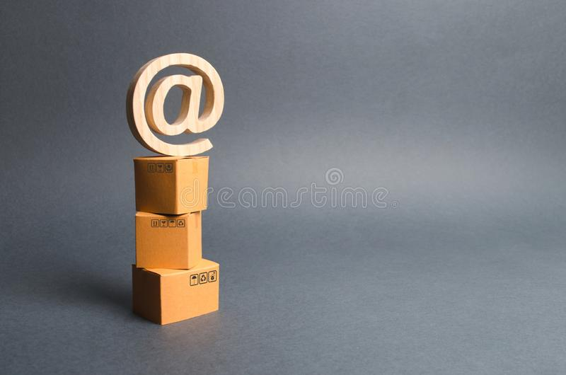Pile of cardboard boxes and email symbol commercial AT. shopping online. development of Internet network trade, advertising. Services. E-commerce. sales of royalty free stock photography