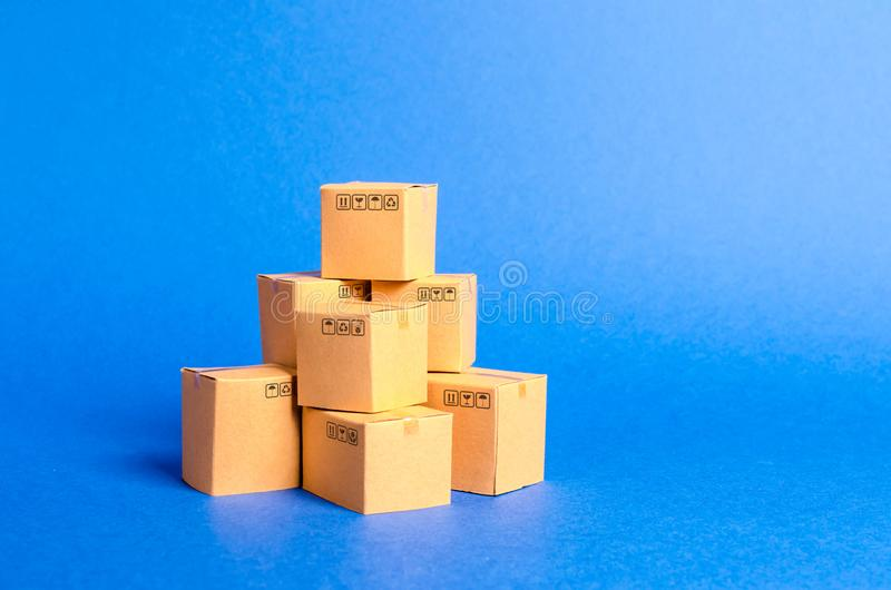 A pile of cardboard boxes. products, goods, commerce and retail. E-commerce, sale of goods through online trading platform royalty free stock photos