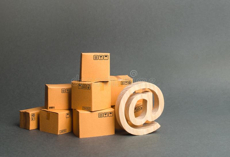 Pile of cardboard boxes and symbol email. shopping. E-commerce. sales of goods and services through online trading platforms. Development of Internet network royalty free stock photos