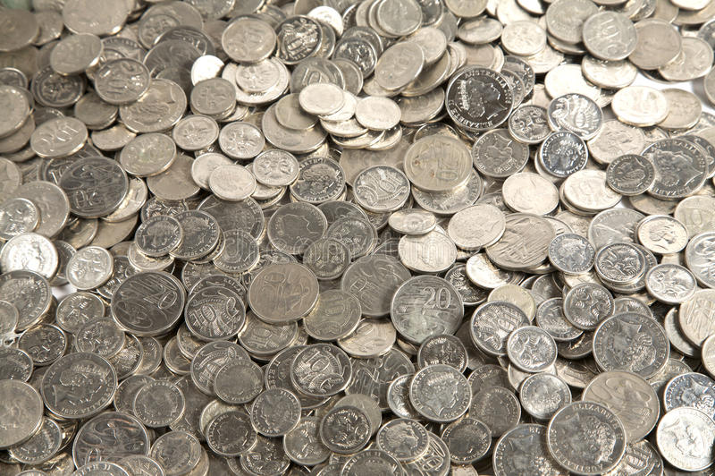 Pile of cash coins. Pile of australian silver coins of different amounts royalty free stock photo
