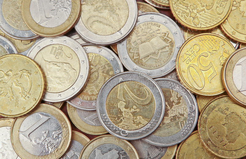 Pile of 50 cents, 1 and 2 euro coins. For background royalty free stock image