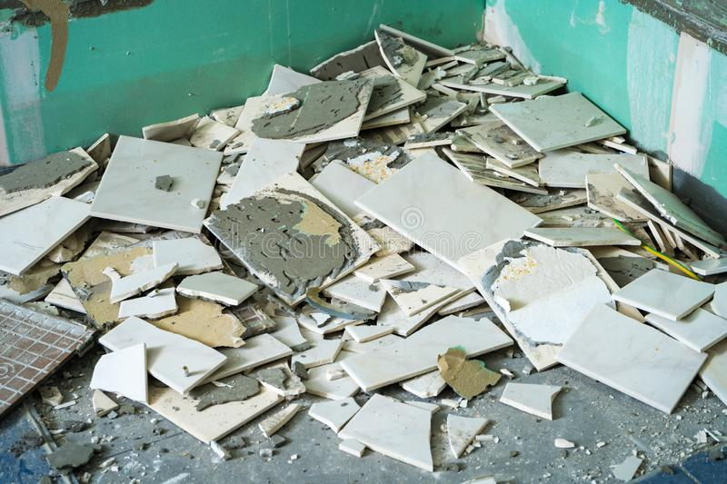 Pile of ceramic tiles remains after bathroom renovation prepared to be thrown into the trash stock photo