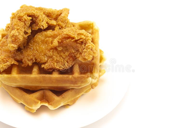 Pile of Chicken and Waffles Isolated on a White Background. A Pile of Chicken and Waffles Isolated on a White Background stock photo